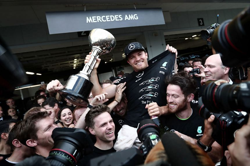 Japanese Grand Prix winner Nico Rosberg being hoisted by his team-mates, as Mercedes celebrated a third straight constructors' championship with four races to go.