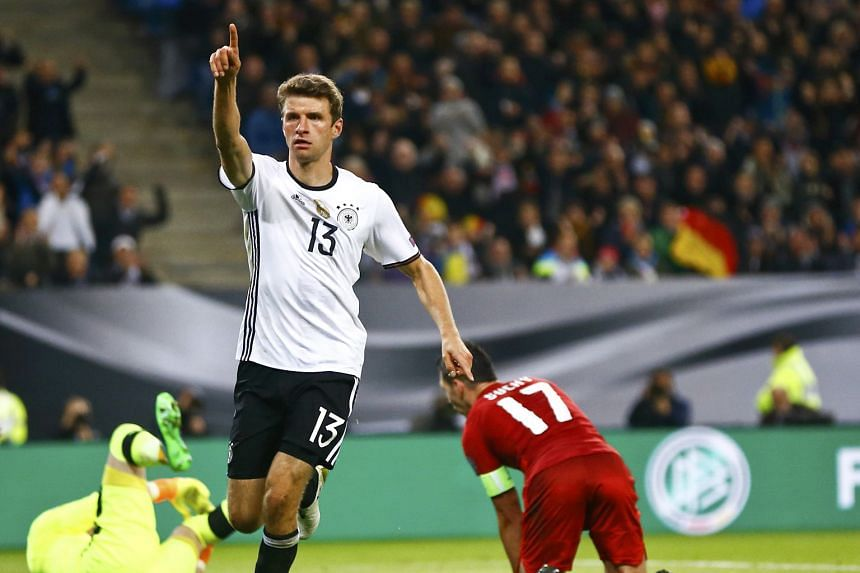 Thomas Muller signals to the crowd after scoring against the Czechs. Coach Joachim Low sees Northern Ireland as even more cautious.