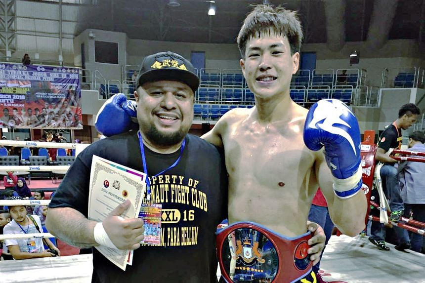 Terrence Teo, with coach Arvind Lalwani, beat his highly fancied Malaysian opponent in Johor in a unanimous five-round decision.