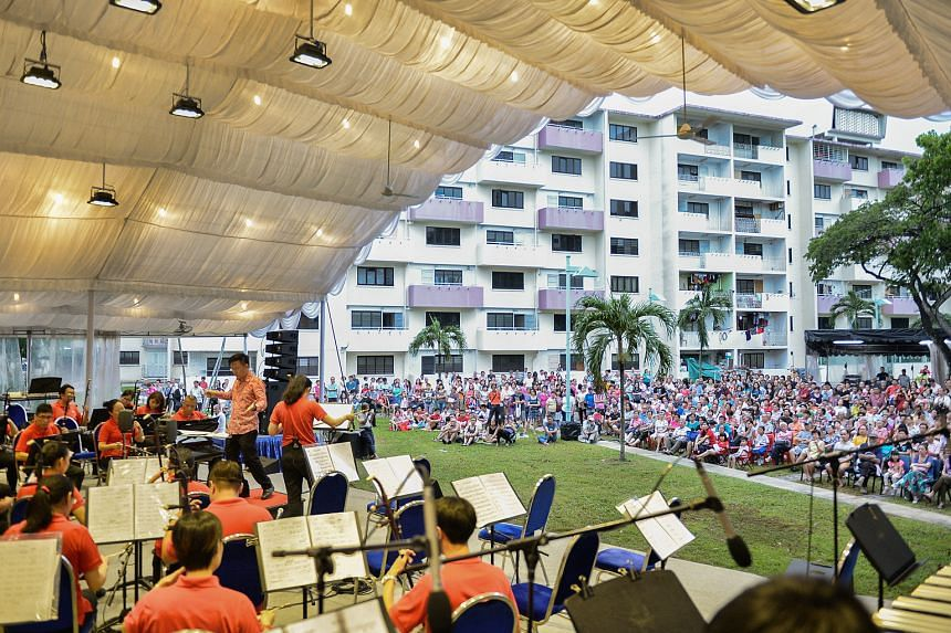 The Singapore Chinese Orchestra performing in a field beside Block 10 in Dakota Crescent in May. The estate in Mountbatten was built by the Singapore Improvement Trust in 1958.