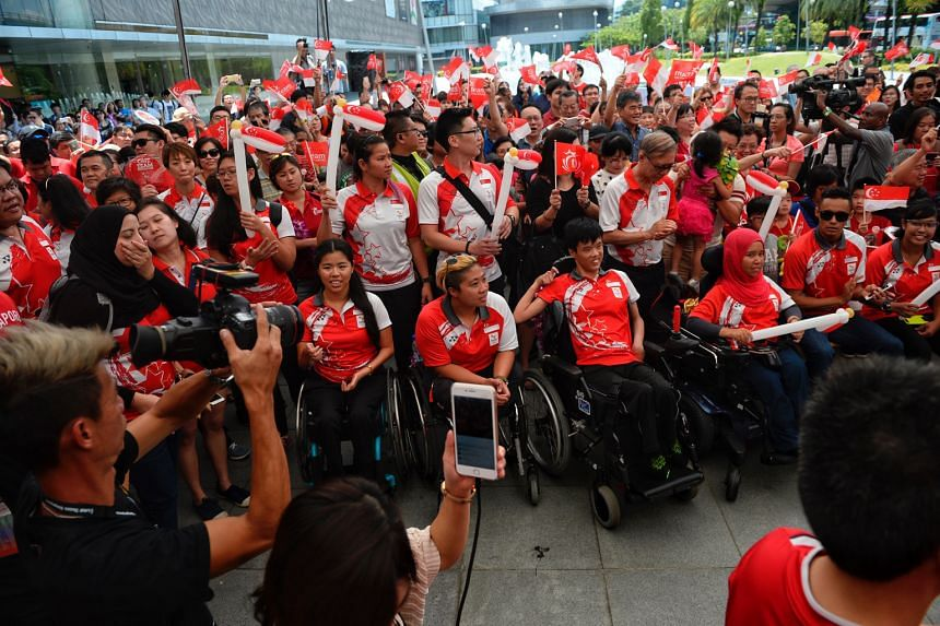 (Seated, from left) Paralympic swimmers Yip Pin Xiu and Theresa Goh, boccia players Toh Sze Ning and Nurulasyiqah Taha, track and field athlete Suhairi Suhani and archer Nur Syahidah Alim at the One Team Singapore celebratory parade last month. The e