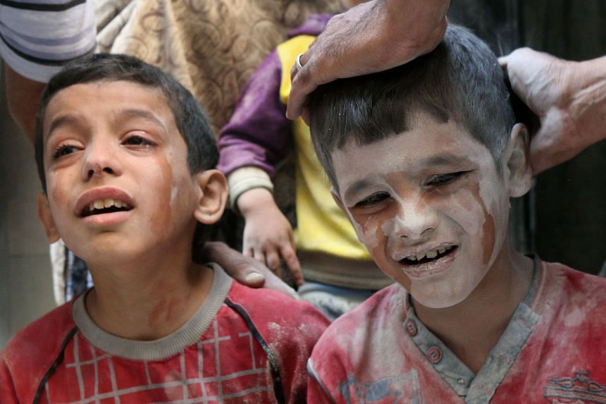 Syrian boys left distraught by Russian air strikes on the rebel-held Fardous neighbourhood in the embattled Syrian city of Aleppo.