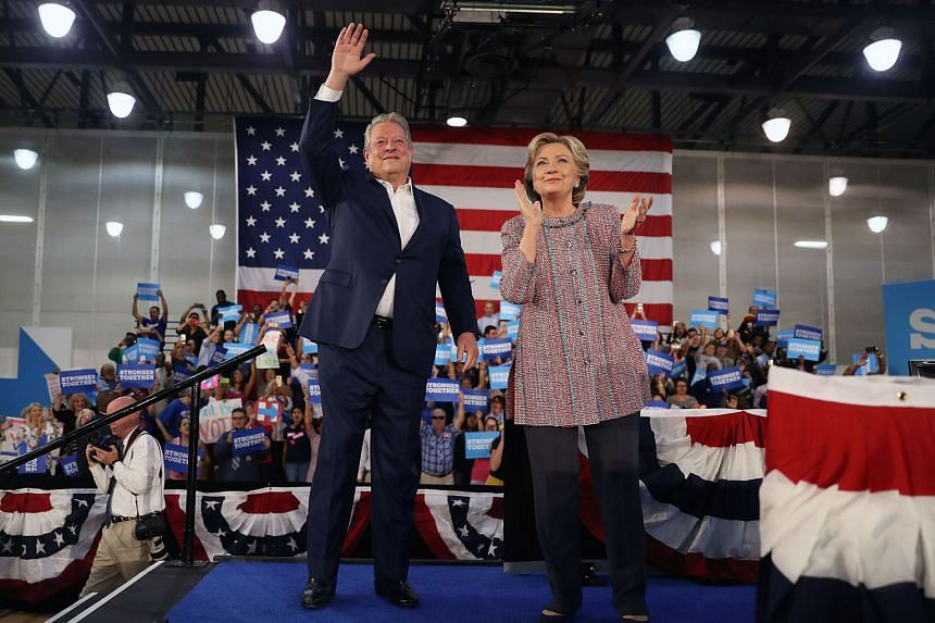 Mr Gore with Mrs Clinton at the Miami Dade College on Tuesday. He vouched for Mrs Clinton's credentials on increasing the use of solar power and other renewable energy.