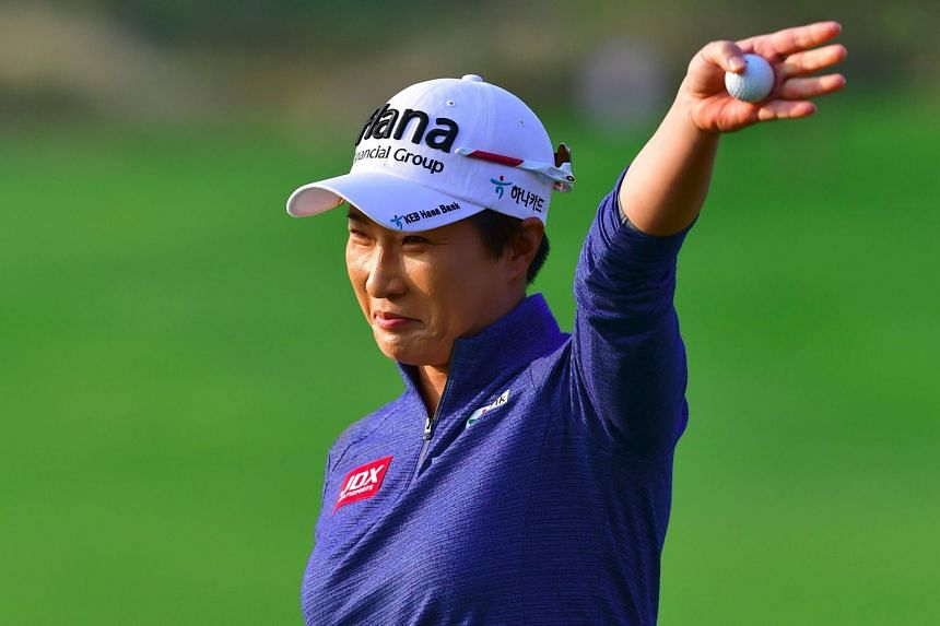 South Korean golf legend Pak Se Ri waving to the crowd at the 18th hole of the Sky72 Golf Club in Incheon. Her first round at the LPGA KEB Hana Bank Championship marked the last of her career.