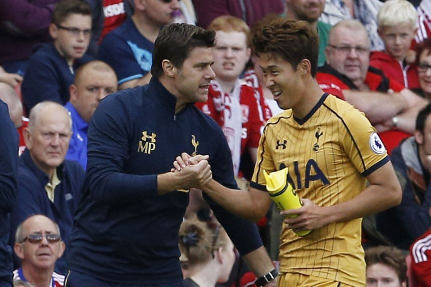 Tottenham manager Mauricio Pochettini (left) congratulates Son Heung Min after the forward scores against Middlesbrough in the Premier League. Spurs won that fixture last month 2-1 and are the only unbeaten side in England's top division this season.