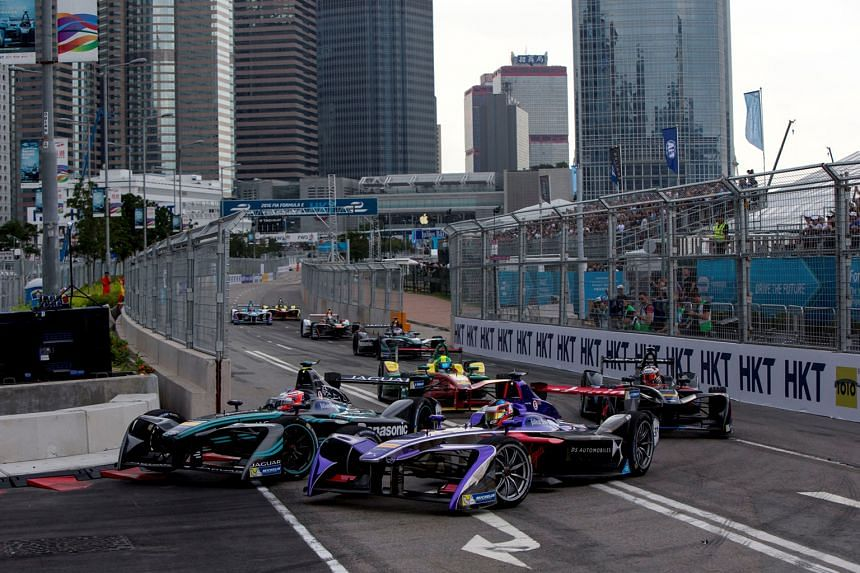 The Panasonic Jaguar Racing I-Type competed in the Formula E Championship Series, which started in Hong Kong. Drivers at the Formula E race going slow and steady at the first hairpin turn.