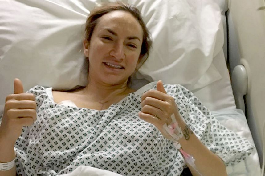 Ms Gabriel, three hours after surgery to remove her breasts last month. The 35-year-old underwent the double mastectomy as a precaution after she tested positive for the BRCA gene mutation.