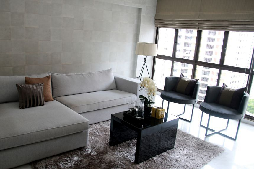 Hues such as brown, taupe and grey dominate the bedroom (left), living room (top) and dining area (above) of the home of Dr Victor Kwok (below).