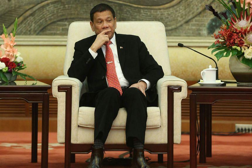 Mr Duterte at a meeting with top legislator Zhang Dejiang at Beijing's Great Hall of the People on Thursday. China is aware that he does not decide on his country's foreign policy on his own, said Chinese analysts.