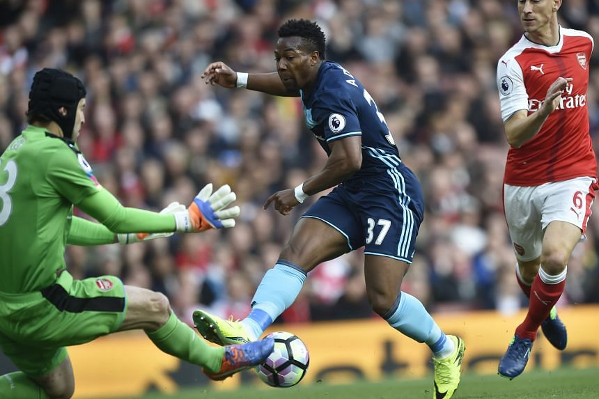 Arsenal stopper Petr Cech saving from Boro winger Adama Traore. The visitors took 11 shots at the Emirates Stadium, compared to Arsenal's nine. Boro hit the target four times.