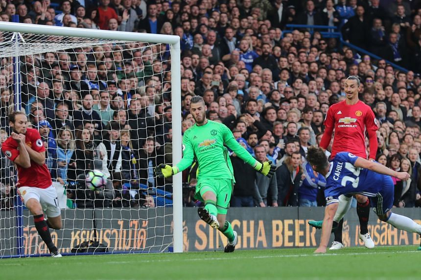 Chelsea defender Gary Cahill scoring his team's second goal via a deflection off Daley Blind. Pedro, Eden Hazard and N'Golo Kante also netted to hand United manager Jose Mourinho his heaviest defeat in the Premier League.