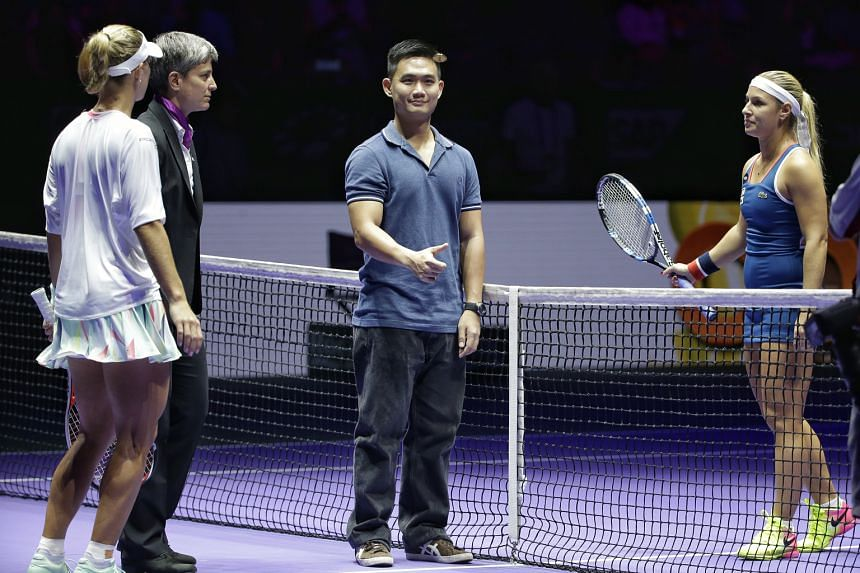PR account executive Sean Long tossing the coin before the match between world No. 1 Angelique Kerber (left) and Dominika Cibulkova, which he watched from the premium section.