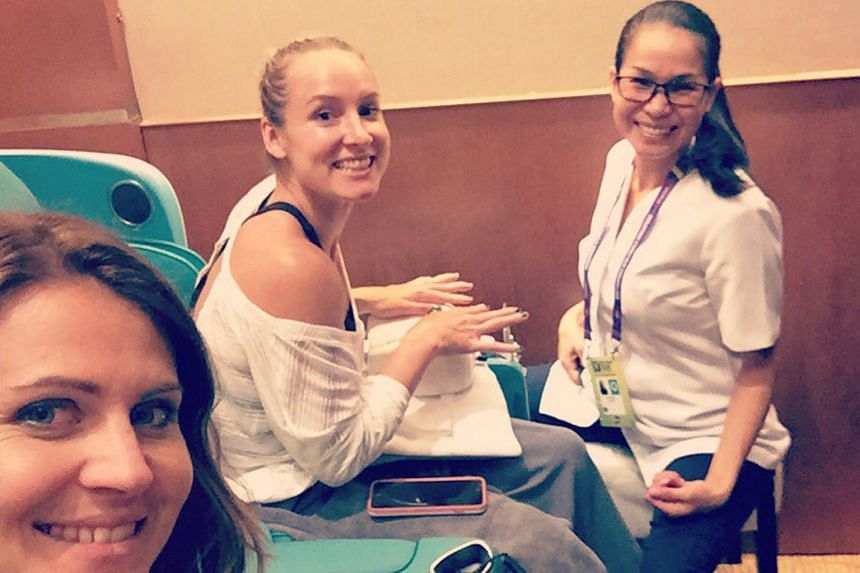 Doubles pair Lucie Safarova (left) and Bethanie Mattek-Sands squeezing in some time for a manicure. The doubles competition, which will use a knockout format this year, starts on Thursday.