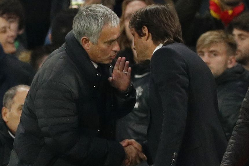 Jose Mourinho and his Chelsea counterpart Antonio Conte after the Blues won 4-0 at Stamford Bridge on Sunday. Neither man would divulge exactly what was said by the Manchester United manager in the touchline exchange.