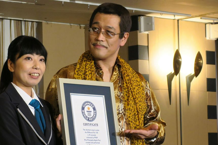 Japanese singer Piko-Taro receiving the Guinness World Record for the shortest song to chart on the US Billboard Hot 100 charts, set by his viral ditty PPAP.