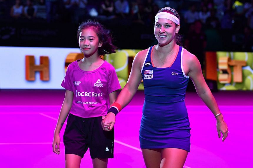 Angelica Bolo entering the court with eventual champion Dominika Cibulkova. She was one of 22 kids selected to walk out with the tennis stars at the WTA Finals Singapore under the Kids Walk-On programme.
