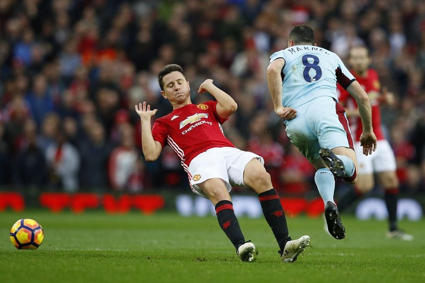 Manchester United's Ander Herrera appears to slip as he makes a challenge on Burnley's Dean Marney, but is controversially sent off. The Premier League match finished goal-less.