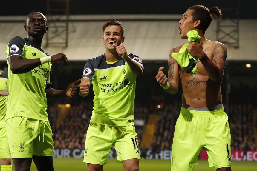 (From right) Liverpool's Roberto Firmino celebrates scoring their fourth goal against Sunderland with Philippe Coutinho and Sadio Mane.