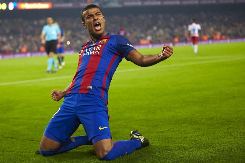 Barcelona's Rafinha celebrates scoring the winner against Granada on Saturday. It was his fifth goal in as many La Liga games.