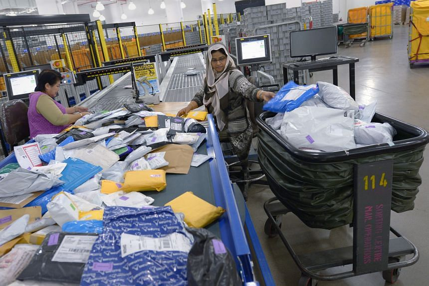 A typical sorting operation at SingPost, where stronger e-commerce logistics volume growth is seen as the key catalyst.