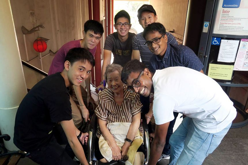 Giving Madam Loh's mother-in-law a lift up the stairs to the restaurant are (from left) Lance Cpl Wong, Pte Ng, Pte Ko, Lance Cpl Teo, 3SG Singh and MSG Johan.
