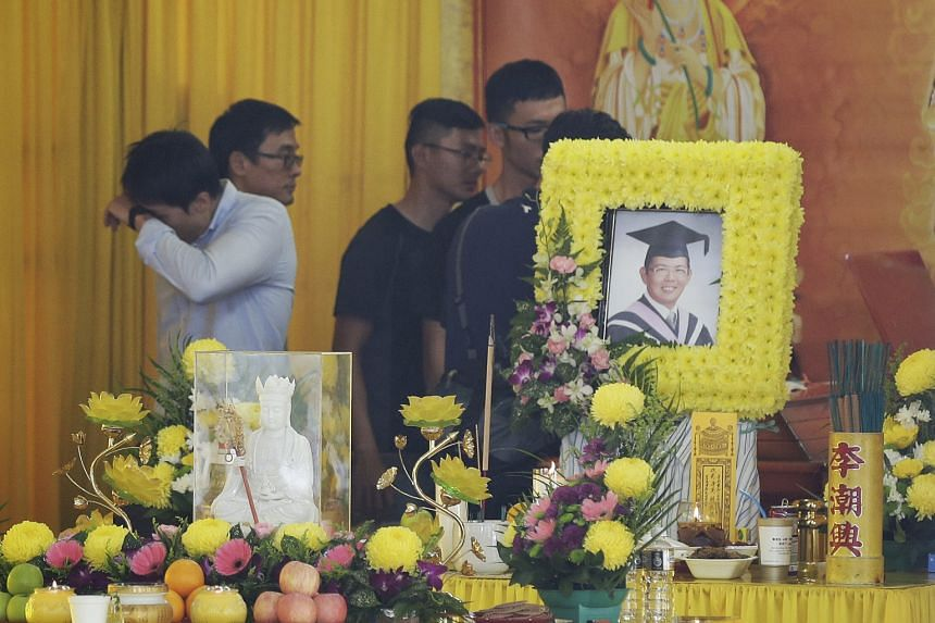 Friends of Mr Koh at his wake yesterday. The 30-year-old was in his kayak last Saturday when it hit driftwood and overturned in a river in Perak, Malaysia.