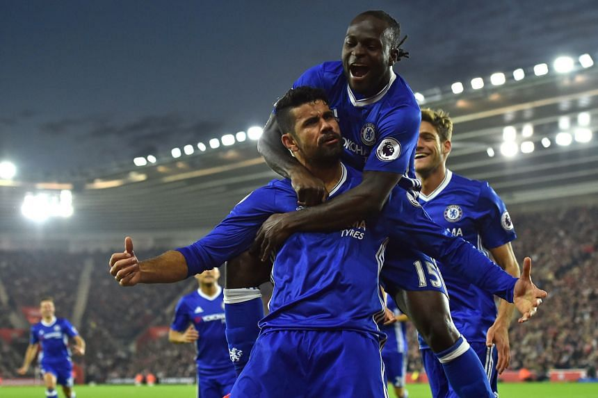 Chelsea's Diego Costa (foreground, with Victor Moses embracing him) celebrates scoring the second goal in their 2-0 victory over Southampton on Sunday.