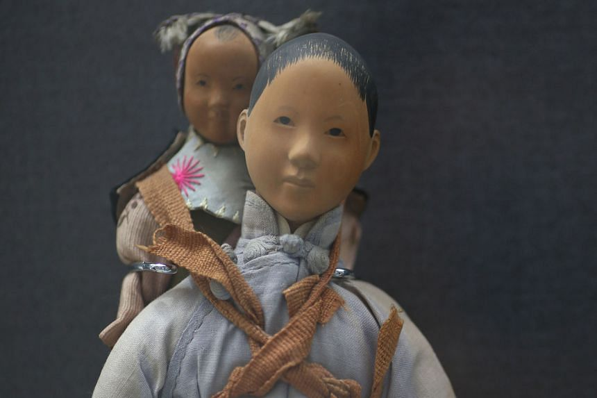 This Door Of Hope doll from the 1900s to 1940s, handcarved from pear wood and on loan from the Mint Museum Of Toys, is one of more than 30 artefacts on display at a special exhibition titled Museum Roundtable: A 20-year Journey. The exhibition, which