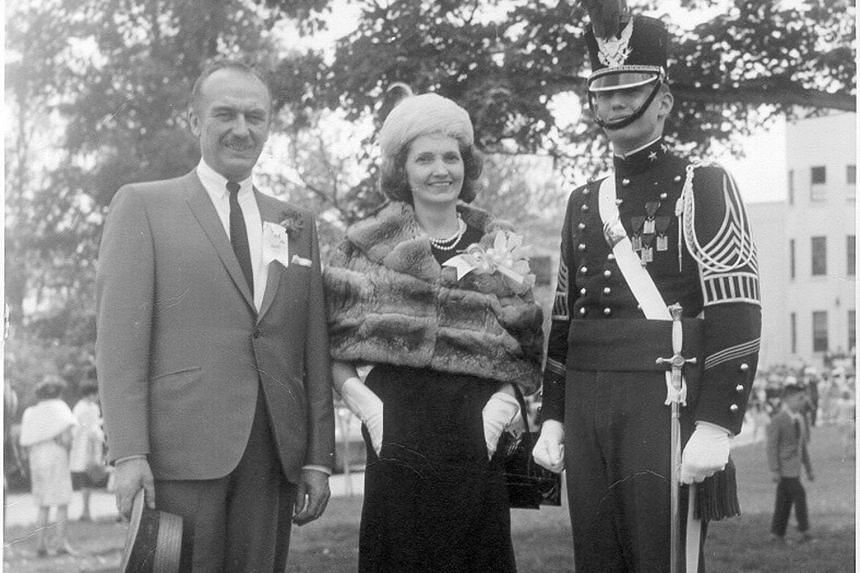 Top: Republican presidential nominee Trump at an Iowa rally in September. Above: Mr Trump (in uniform), seen here with his parents, credits the New York Military Academy with giving him his ruthless streak.