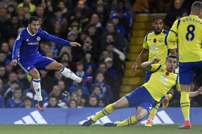 """Chelsea's Eden Hazard (left) scoring the first of his two goals during the 5-0 victory against Everton on Saturday. """"Eden is fantastic with the ball and he is fantastic without the ball,"""" said Antonio Conte after the match."""
