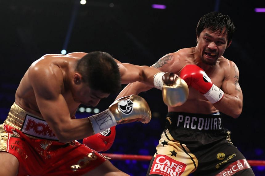 American Jessie Vargas reeling against Manny Pacquiao during the latter's victory in their WBO welterweight championship fight in Las Vegas on Saturday.