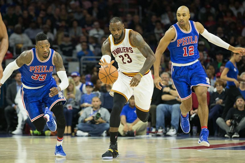 """Cleveland Cavaliers forward LeBron James accelerating past Philadelphia 76ers forward Robert Covington during the 102-101 victory at Wells Fargo Centre on Saturday. James said there was still """"room for improvement""""."""