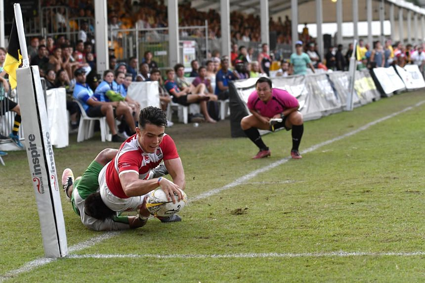 England Academy's Callum Sirker, 18, evading the challenge of Sunnybank's Junior Laloifi while attempting a try en route to a 40-21 victory in the final of the SCC International Rugby Sevens tournament.
