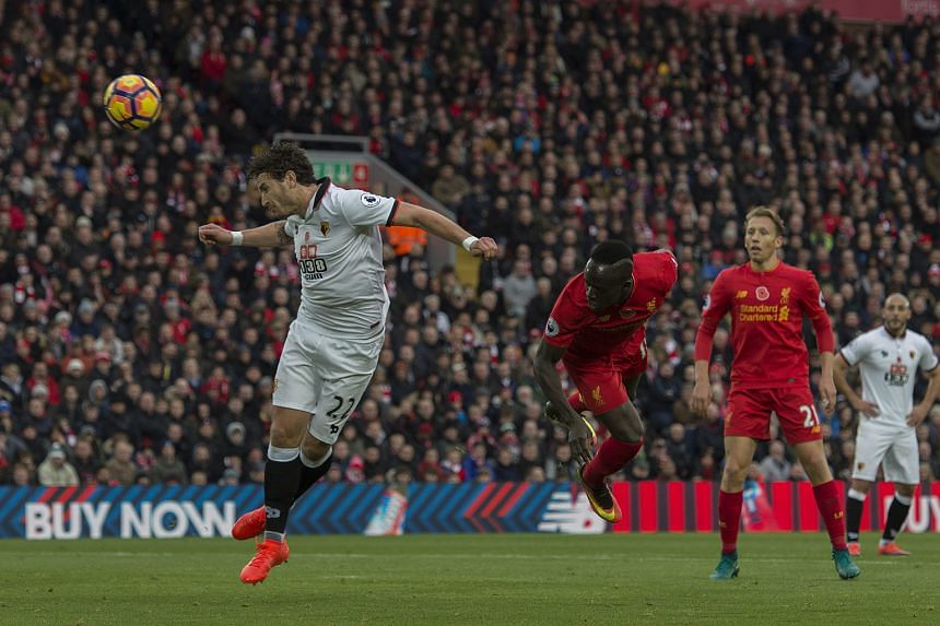 Liverpool's Sadio Mane stooping to head in the opening goal against Watford at Anfield. His double and strikes by Philippe Coutinho, Emre Can, Roberto Firmino and Georginio Wijnaldum gave the Reds a 6-1 win but manager Jurgen Klopp is not keen on any