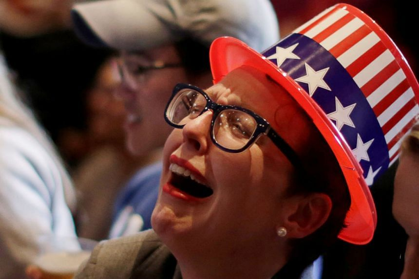 Above and below: Clinton supporters were openly shocked and upset as the night wore on and the results streamed in at the Jacob Javits Convention Centre in New York.