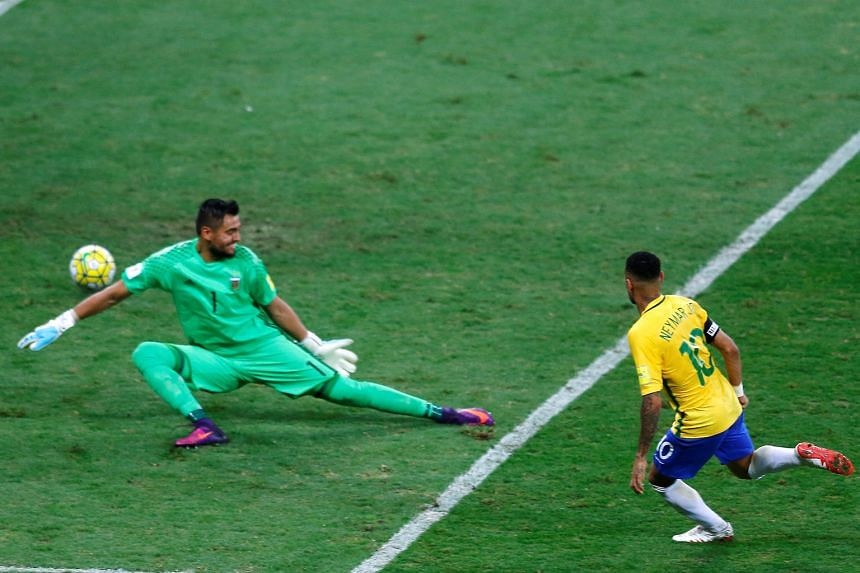 From top: Brazil's Neymar (centre) celebrating with team-mates Philippe Coutinho (left) and Gabriel Jesus after scoring against Argentina in first-half stoppage time. Neymar slotting the ball past Argentina goalkeeper Sergio Romero during the World C