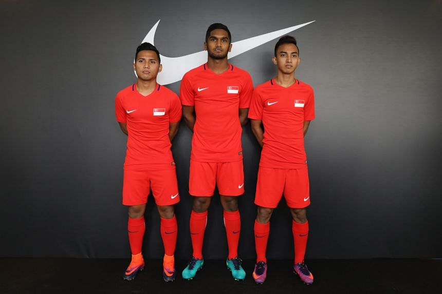 Showing off the new Nike team kit yesterday are (from left) forward Sahil Suhaimi, midfielder Hariss Harun and winger Faris Ramli. They tackle co-hosts the Philippines in their opening AFF Cup match.