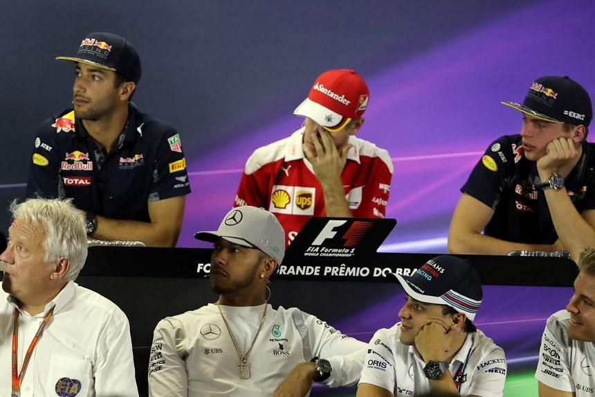 F1 race director Charlie Whiting (bottom left) leading the drivers' media conference at the Brazilian Grand Prix. Sebastian Vettel (in red) and his Ferrari team have yet to record a win going into the penultimate race of the season, and his frustrati
