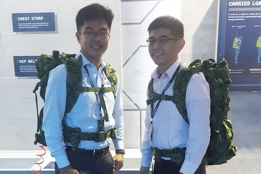 DSO technical staff Yee Qing Xiang (at left) and Cheong Chee Hoong wearing the newly developed A-Lite Pack at the SGDefence exhibition at Marina Bay Sands last week.