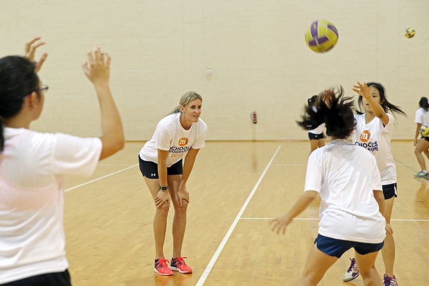 Leana de Bruin, the New Zealand two-time Commonwealth Games netball gold medallist, conducting an hour-long clinic for 24 local student-players at the OCBC Arena yesterday. She put them through different passing drills during the session, which was p