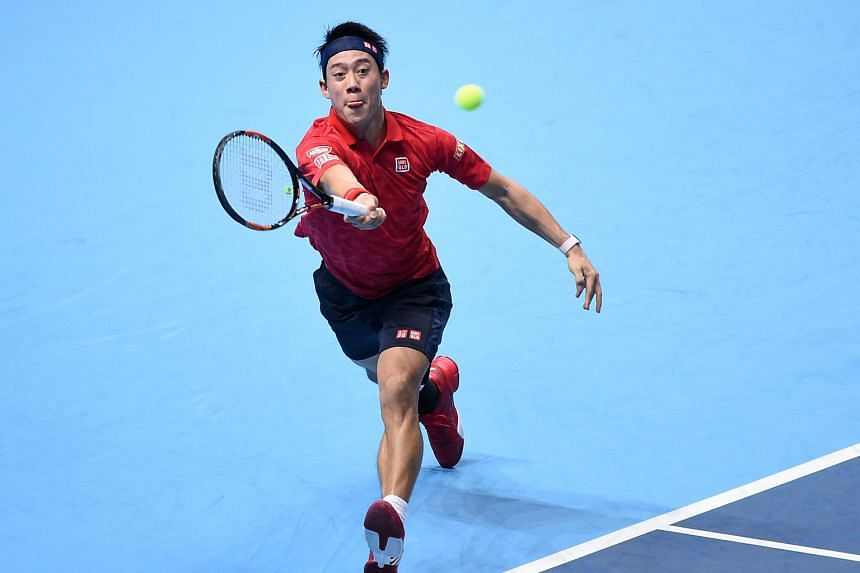 Kei Nishikori returning to Stan Wawrinka in their ATP Tour Finals group opener in London. The error-ridden Swiss was no match for the ruthlessly efficient Japanese, whose semi-final chances have risen.