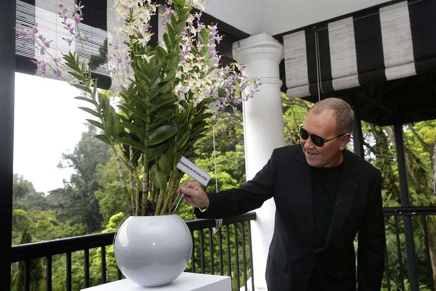 Fashion designer Kors with the Dendrobium Michael Kors at the National Orchid Garden. He plans to grow the namesake orchid at his new home in Florida.