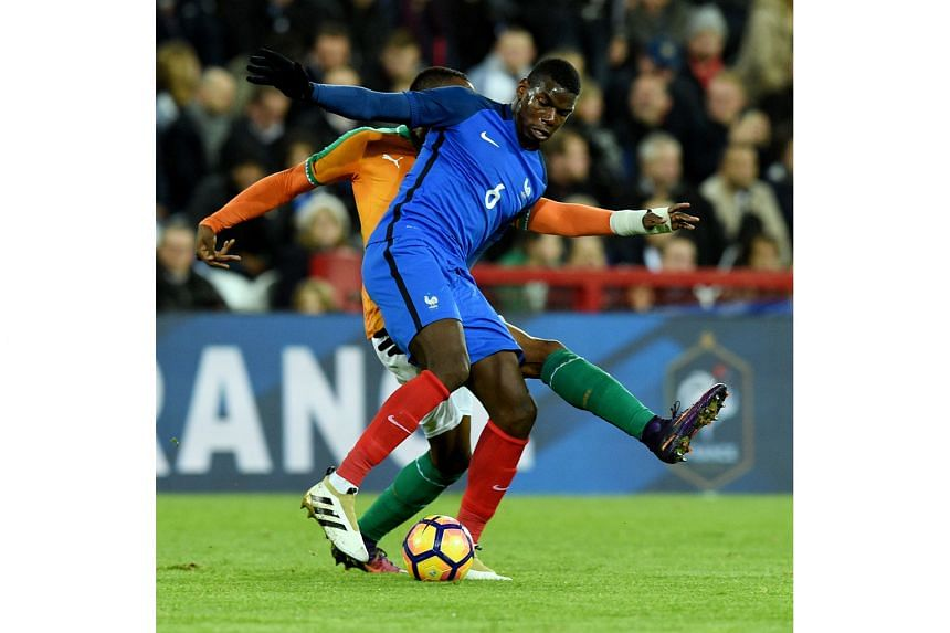 France's Paul Pogba, one of the few stalwarts who kept their starting spots, tries to control the ball against Ivory Coast.