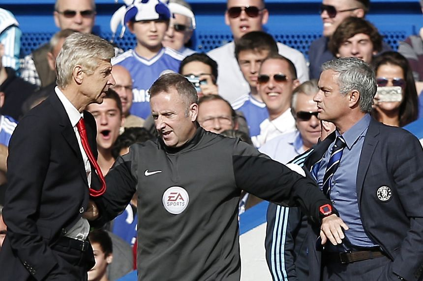 Jose Mourinho (right) and Arsene Wenger being kept apart by the fourth official Jonathan Moss during a Premier League match between Chelsea and Arsenal at Stamford Bridge two years ago.