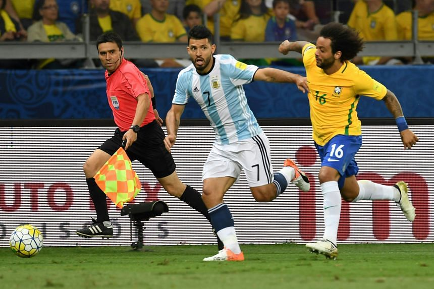 Manchester City's Argentina forward Sergio Aguero holding off Brazil's Marcelo during last week's World Cup qualifier. Despite the defeat, City's top scorer came through unscathed and is in line to lead Guardiola's attack when they visit Crystal Pala