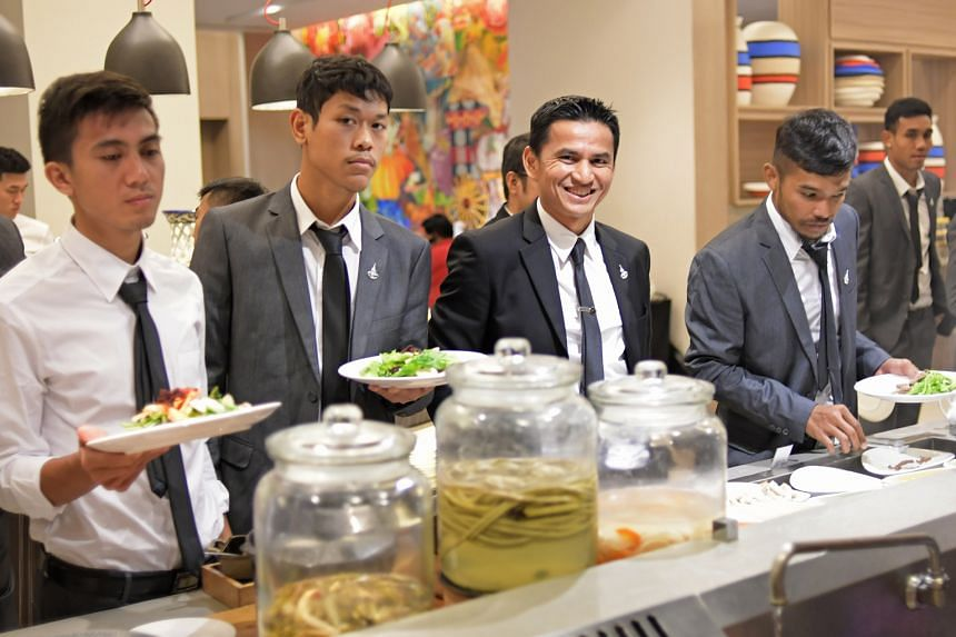 The Thai football team, led by their coach Kiatisuk Senamuang (second from right), are odds-on favourites to defend their AFF Cup title. Thailand begin their campaign against Indonesia today.