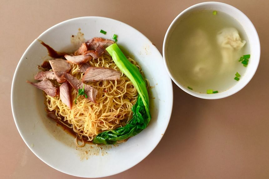 Jian Kang's dry wonton noodles come with a full stalk of vegetable and lean char siew.
