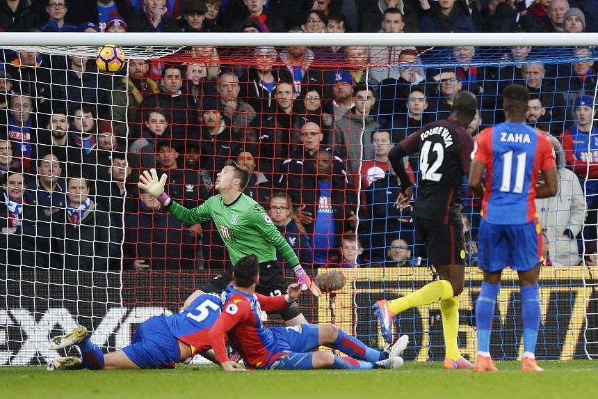 Manchester City's Yaya Toure scoring the first of his two goals against Crystal Palace in an English Premier League match which ended 2-1.