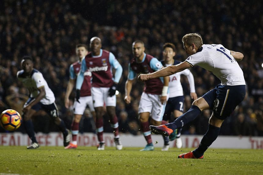 Harry Kane giving Tottenham full points with his spot kick in stoppage time, as the north London team's unbeaten run in the league stretches to 12 matches.
