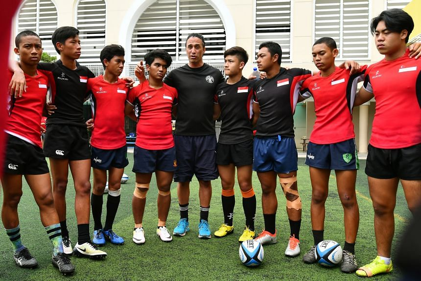 Former New Zealand rugby sevens skipper Karl Te Nana (fifth from left) is in town to select two teenagers to train in New Zealand.